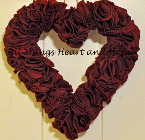 Close-up-of-felt-heart-wrea