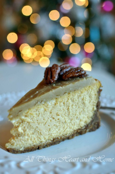 pumpkin cheesecake with gingersnap pecan crust and praline topping